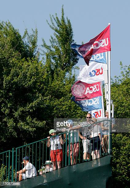 Fans watch play from a grandstand during a practice round prior to the start of the 113th U.S. Open at Merion Golf Club on June 12, 2013 in Ardmore,...