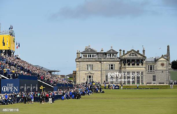 Fans watch play from a grandstand on the first hole during the Champion Golfers' Challenge ahead of the 144th Open Championship at The Old Course on...