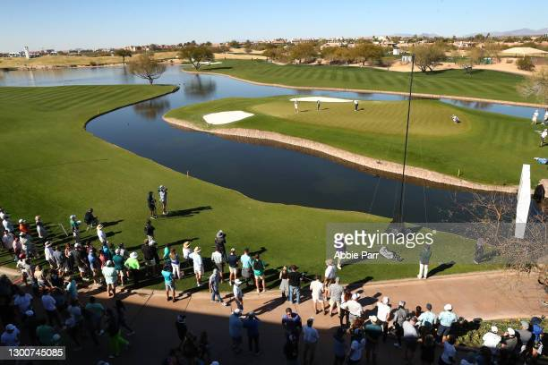 Fans watch play from the 14th green during the third round of the Waste Management Phoenix Open at TPC Scottsdale on February 06, 2021 in Scottsdale,...