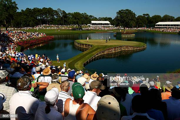 Fans watch play on the 17th hole during the third round of THE PLAYERS Championship on THE PLAYERS Stadium Course at TPC Sawgrass on May 9 2009 in...