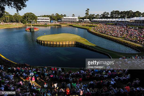 Fans watch play on the 17th hole island green during the final round of THE PLAYERS Championship on THE PLAYERS Stadium Course at TPC Sawgrass on May...