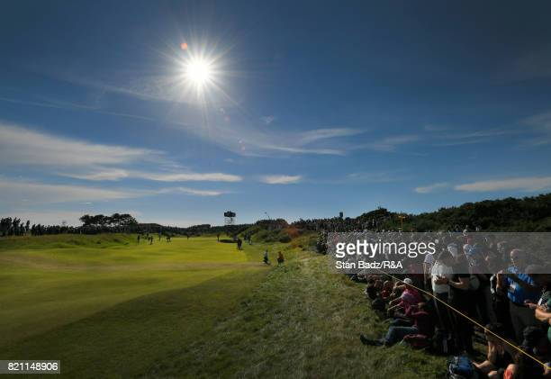 Fans watch play on the tenth hole during the third round of the 146th Open Championship at Royal Birkdale on July 22 2017 in Southport England