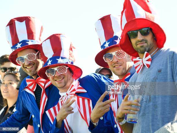 US fans watch play on the third hole during the Sunday singles matches at the Presidents Cup at Liberty National Golf Club on October 1 in Jersey...