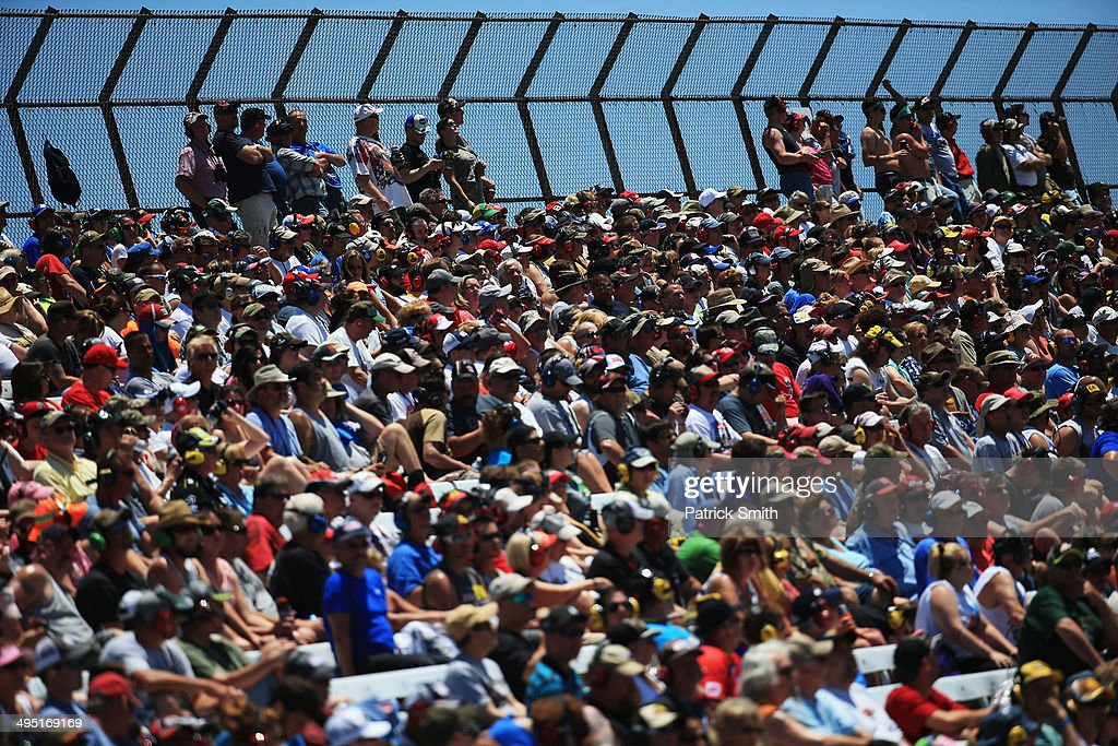 Fans watch race action during the NASCAR Sprint Cup Series FedEx 400 Benefiting Autism Speaks at Dover International Speedway on June 1, 2014 in Dover, Delaware.