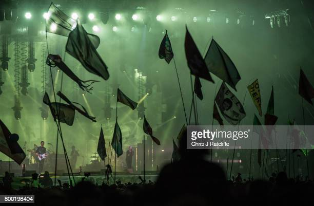 Fans watch Radiohead headline on the Pyramid Stage at Glastonbury Festival Site on June 23 2017 in Glastonbury England The largest greenfield...