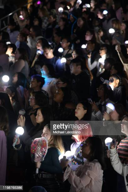 """Fans watch Seventeen perform in concert during their """"Ode to You"""" tour at Prudential Center on January 10, 2020 in Newark, New Jersey."""