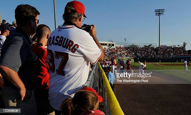 Fans watch Stephen Strasburg warm-up before the game agains the Pelicans in Woodbridge, VA on August 12, 2011.