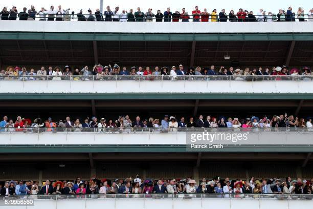 Fans watch the 143rd running of the Kentucky Derby at Churchill Downs on May 6 2017 in Louisville Kentucky