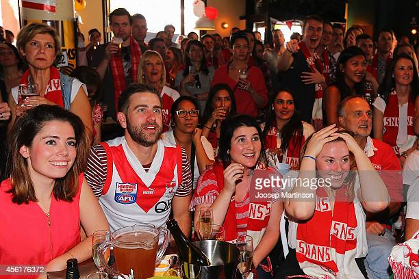 Fans watch the 2014 AFL Grand Final at the MCG from Light Brigade Hotel on September 27 2014 in Sydney Australia