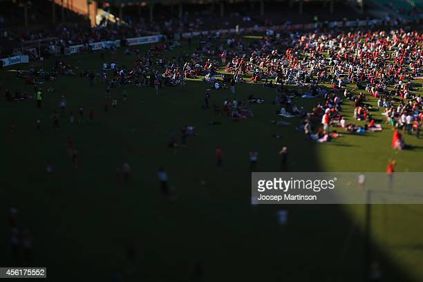Fans watch the 2014 AFL Grand Final at the MCG from the Sydney Swans Live Site at Sydney Cricket Ground on September 27 2014 in Sydney Australia
