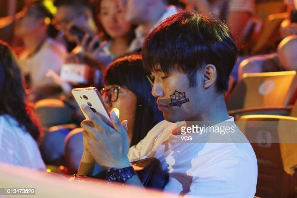 Fans watch the 2018 Honor of Kings Champion Cup eighth-final between EMC and AHQ on August 4, 2018 in Beijing, China.