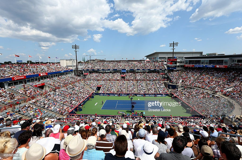 Fans watch the action between Serena Williams of the USA and Venus Williams of the USA during the women's semifinals match in the Rogers Cup at Uniprix Stadium on August 9, 2014 in Montreal, Canada.