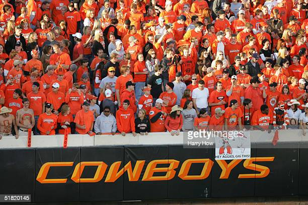 Fans watch the action between the Texas AM Aggies and Oklahoma State Cowboys at Boone Pickens Stadium on October 16 2004 in Stillwater Oklahoma Texas...