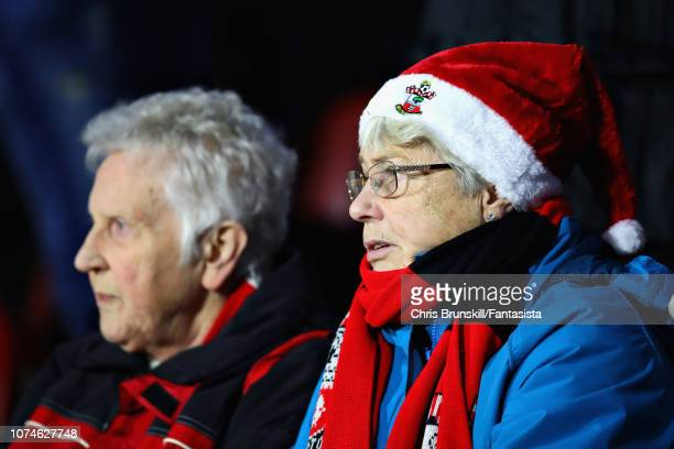 Fans watch the action during the Premier League match between Huddersfield Town and Southampton FC at John Smith's Stadium on December 22 2018 in...