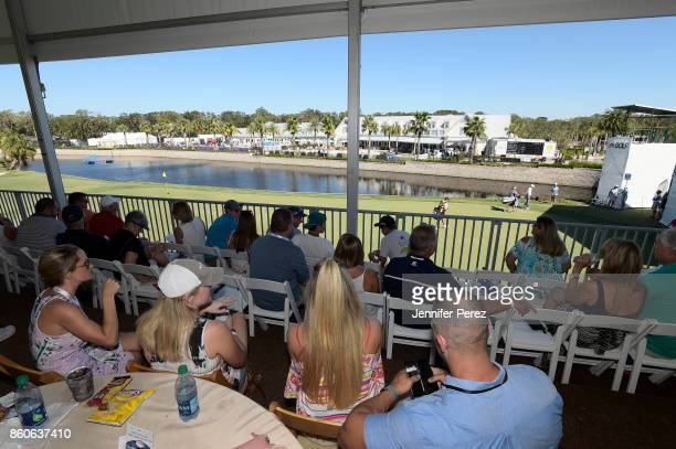 Fans watch the action from a hospitality venue on the 18th green during the second round of the Webcom Tour Championship at Atlantic Beach Country...