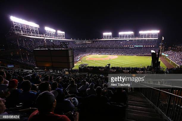 Fans watch the action from a rooftop during Game 3 of the NLCS between the New York Mets and the Chicago Cubs at Wrigley Field on Tuesday October 20...