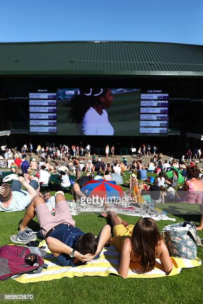 Fans watch the action from Murray Mound on day one of the Wimbledon Lawn Tennis Championships at All England Lawn Tennis and Croquet Club on July 2...