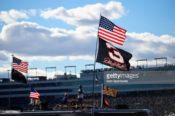 Fans watch the action from the infield during the Pennzoil 400 Monster Energy NASCAR Cup Series race on March 3 at the Las Vegas Motor Speedway in...