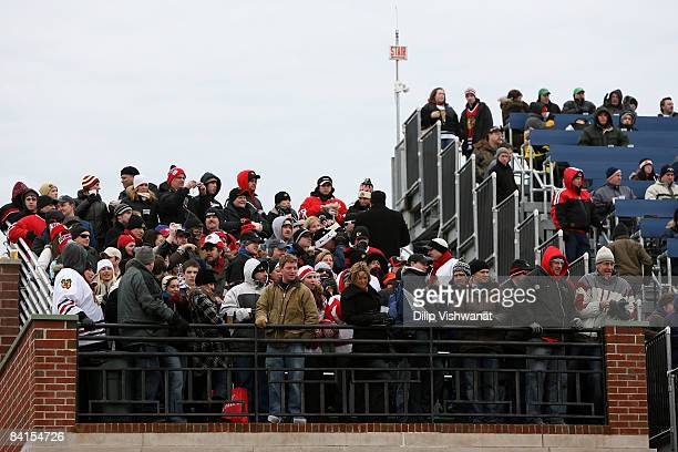 Fans watch the action from the rooftops during the NHL Winter Classic between the Chicago Blackhawks and the Detroit Red Wings at Wrigley Field on...