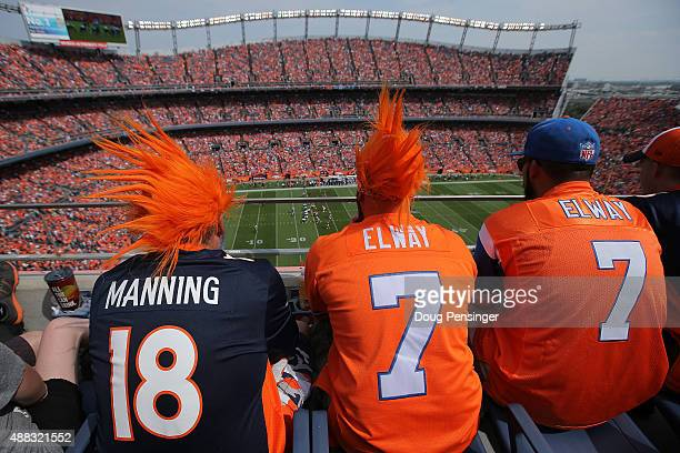 Fans watch the action from the upper deck dressed in John Elway and Peyton Manninger jerseys as the Baltimore Ravens face the Denver Broncos at...