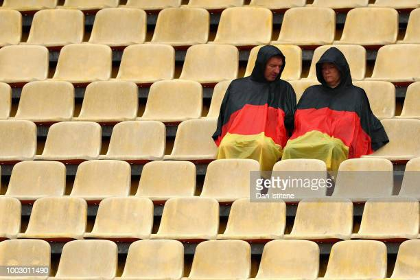 Fans watch the action in the rain during final practice for the Formula One Grand Prix of Germany at Hockenheimring on July 21 2018 in Hockenheim...
