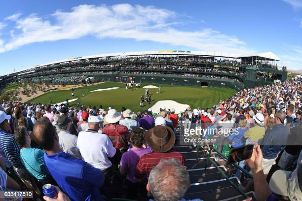 Fans watch the action on the 16th hole during the Pro Am prior to the Waste Management Phoenix Open at TPC Scottsdale on February 1 2017 in...