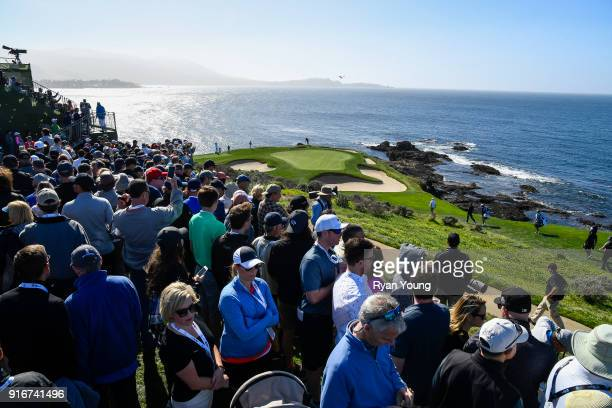 Fans watch the action on the seventh hole during the third round of the ATT Pebble Beach ProAm at Pebble Beach Golf Links on February 10 2018 in...