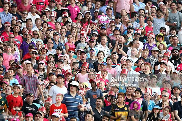 Fans watch the ball race towards the boundary during the Big Bash League match between the Sydney Sixers and Hobart Hurricanes at Sydney Cricket...