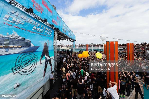 Fans watch the band Alestorm perform on the pool deck stage and toss an inflatable rubber duck around onboard the cruise liner 'Independence of the...