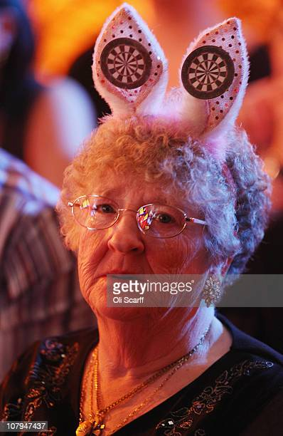 Fans watch the BDO World Darts Championship final between Martin 'Wolfie' Adams and Dean Winstanley at the Lakeside Country Club on January 9 2011 in...