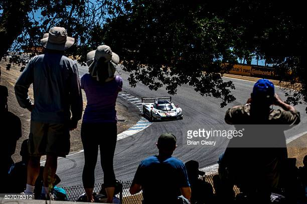 Fans watch the Corvette DP of Joao Barbosa and Christian Fittipaldi as it races through the corkscrew during the IMSA WeatherTech Series race at...