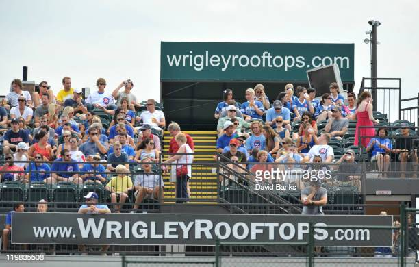 Fans watch the Cubs play the Astros from the rooftops on July 23 2011 at Wrigley Field in Chicago Illinois