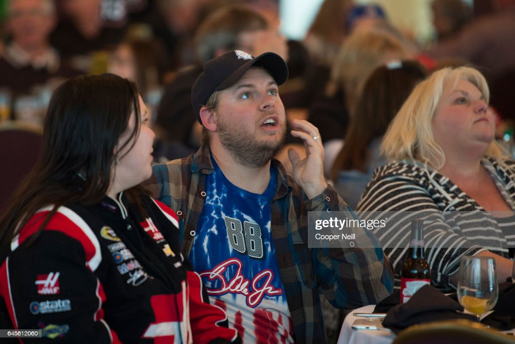 Fans watch the Daytona 500 at a watch party in the Grand Ballroom at Texas Motor Speedway on February 26, 2017 in Fort Worth, Texas.