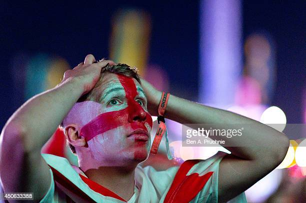 Fans watch the England vs Italy match at The Isle of Wight Festival at Seaclose Park on June 14 2014 in Newport Isle of Wight