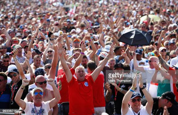 Fans watch the England vs Sweden World Cup match after qualifying for the Formula One Grand Prix of Great Britain at Silverstone on July 7 2018 in...