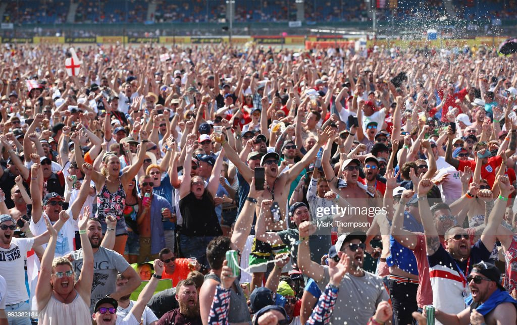Fans watch the England vs Sweden World Cup match after qualifying for the Formula One Grand Prix of Great Britain at Silverstone on July 7, 2018 in Northampton, England.