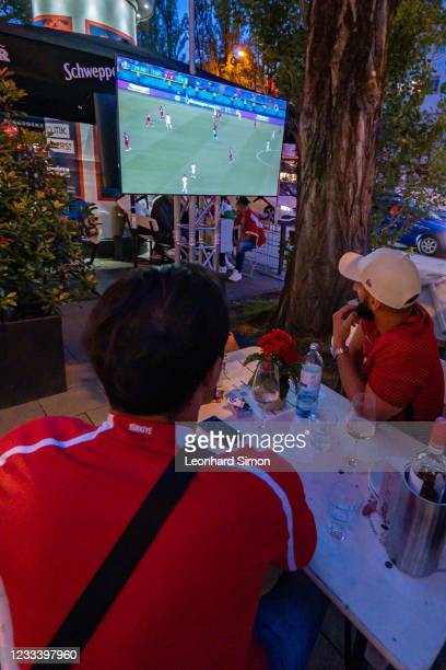 Fans watch the EURO 2020 kick-off match between Turkey and Italy on June 11, 2021 at Leopoldstraße in Munich, Germany.