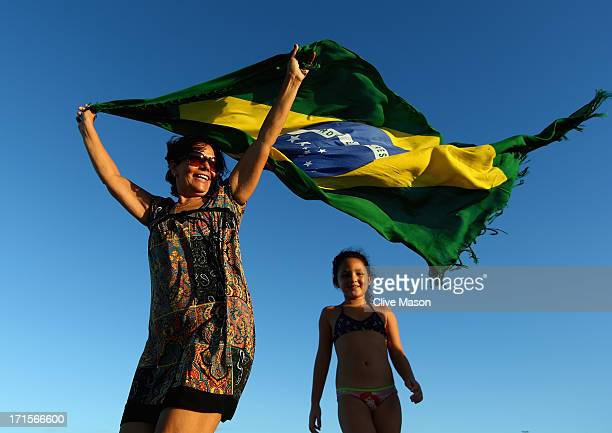 Fans watch the FIFA Confederations Cup first semi final match between Brazil and Uruguay on Praia Futuro on June 26 2013 in Fortaleza Brazil