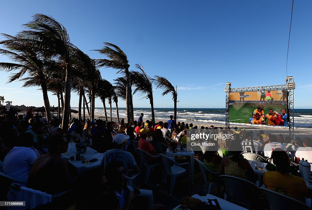 Fans watch the FIFA Confederations Cup, first semi final match between Brazil and Uruguay, on Praia Futuro on June 26, 2013 in Fortaleza, Brazil.
