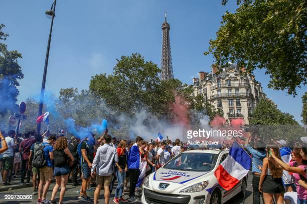Fans watch the FIFA World Cup final match between France and Croatia at Fan Zone at Champ de Mars on July 15 2018 in Paris France