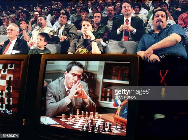 Fans watch the fifth game between World Chess Champion Garry Kasparov and the IBM Deep Blue computer 10 May in New York The game is broadcast to the...