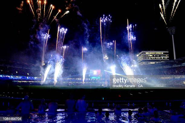 Fans watch the fireworks and laser display from the pool during the Big Bash League match between the Brisbane Heat and the Adelaide Strikers at The...