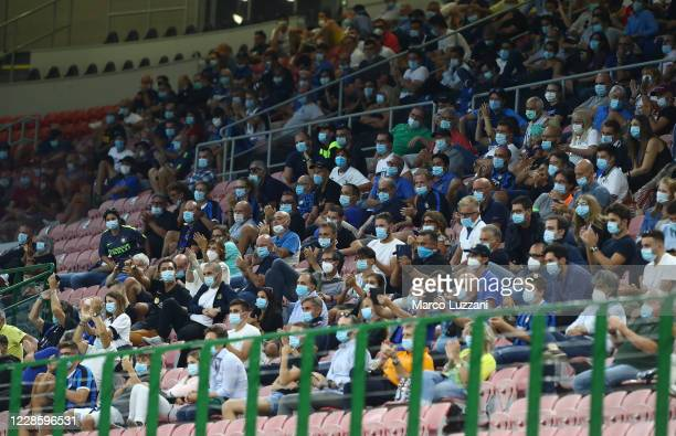Fans watch the friendly match between FC Internazionale and SC Pisa at Stadio Giuseppe Meazza on September 19, 2020 in Milan, Italy. A limit of 1,000...