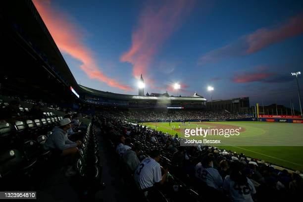 Fans watch the game between the New York Yankees and Toronto Blue Jays as the sun sets at Sahlen Field on June 16, 2021 in Buffalo, New York.