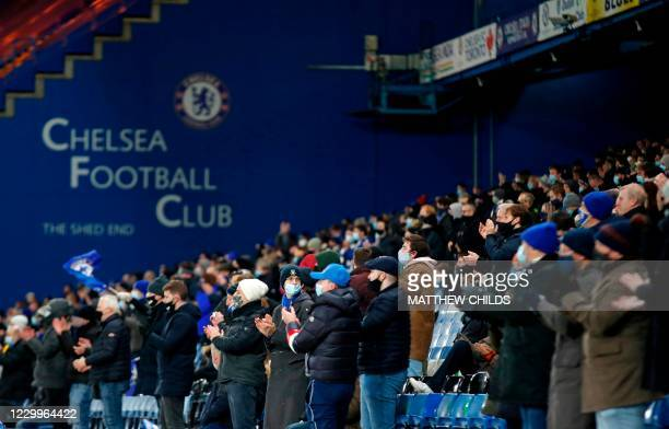 Fans watch the game during the English Premier League football match between Chelsea and Leeds United at Stamford Bridge in London on December 5,...