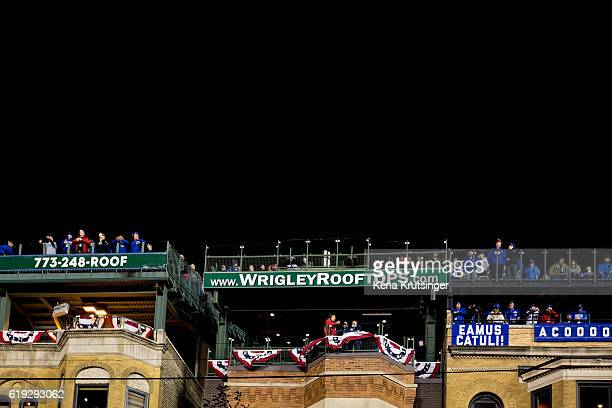 Fans watch the game from rooftops during Game Three of the 2016 World Series between the Chicago Cubs and the Cleveland Indians at Wrigley Field on...