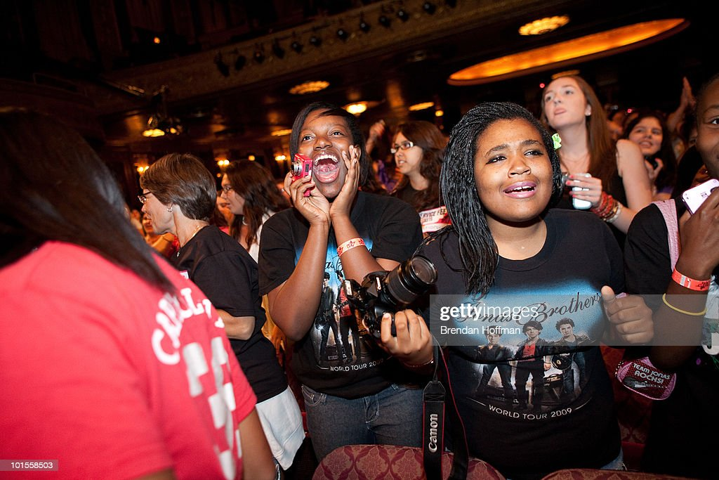 Fans watch the Jonas Brothers perform for the Live Nation NSF Event at the Warner Theatre on June 2, 2010 in Washington, DC.