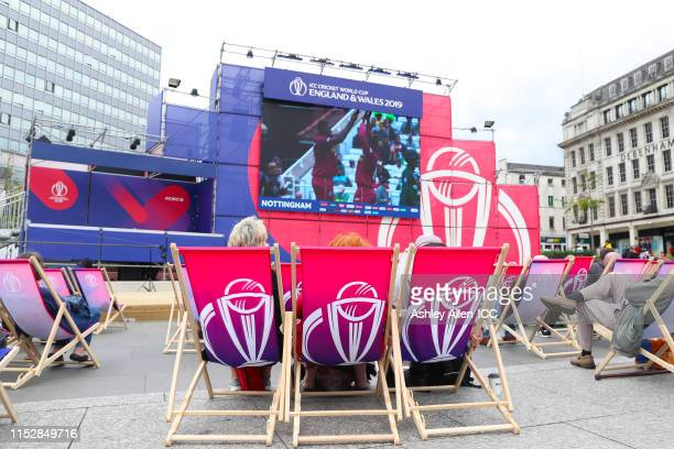 Fans watch the match during a visit to the Nottingham fanzone during the ICC Cricket World Cup 2019 at Old Market Square on May 31, 2019 in...
