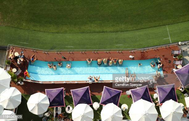 Fans watch the match from the pool deck during day four of the First Test match in the series between Australia and New Zealand at Optus Stadium on...