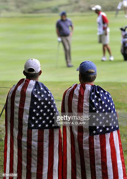 USA Fans watch the match of Phil Mickelson and Anthony Kim of the United States against Team Europe players Henrik Stenson and Oliver Wilson during...